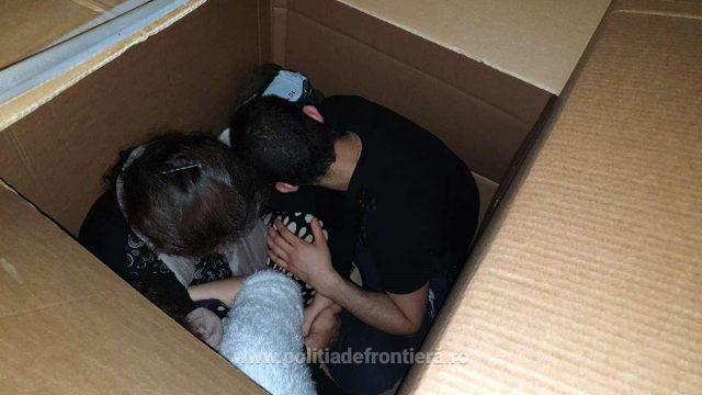 Migranți în cutii de carton